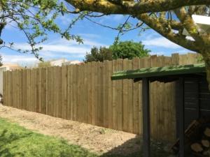 clôture bois mur